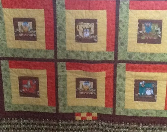 Crib Quilt for baby or toddler in bright oranges, yellows, greens and browns with owls
