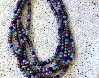Multi-strand, multi-color pearlized necklace