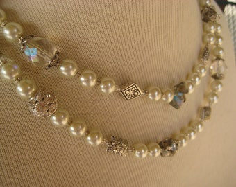 Pearl necklace, with aurora borealis crystals and silver charms