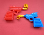 Vintage Space Ray Gun K Paper Roll Gun pistol set of 2 1960's