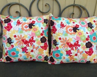 Pair of Cushion Covers in Flower Garden in Multi, Just Wing It by MoMo for Moda, backed in Dumb Dot in Candy Pink by Michael Miller