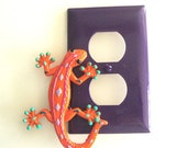 Funky Orange Tropical Gecko on a Purple Outlet Plate