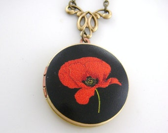 Red Poppy Pendant Necklace, Locket Red Poppy On A Brass Locket On Black Background.