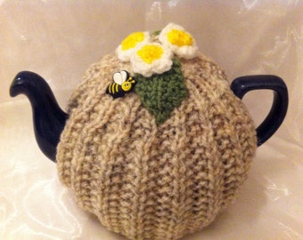 Floral knitted teapot cosy