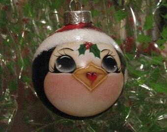 Penguin ornament with Santa hat.