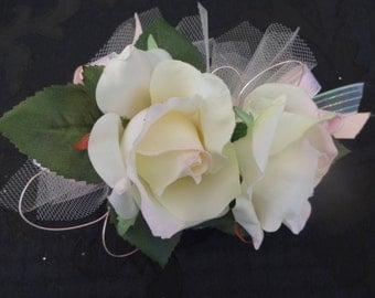 2 Piece wrist corsage and boutonniere in white with a touch of pink roses