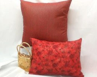 Decorator pillow covers with Red and Gold accents.