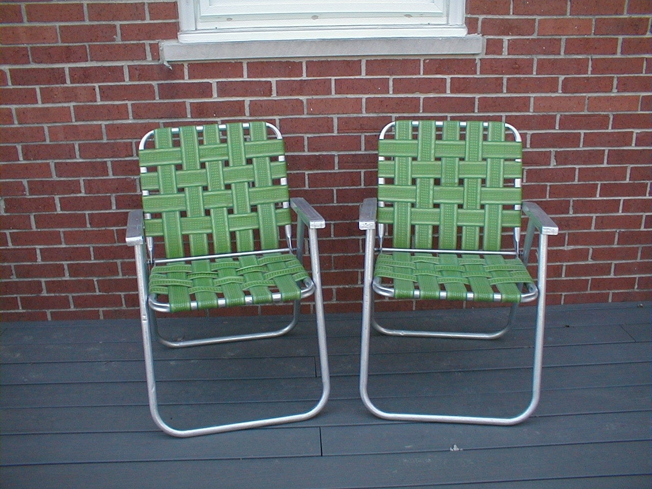 pair vintage folding aluminum webbed lawn chairs lime green