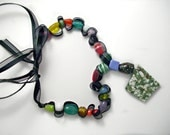 Jade triangle mosaic pendant necklace. Bright colored beads. Black ribbon. Beaded ribbon necklace.