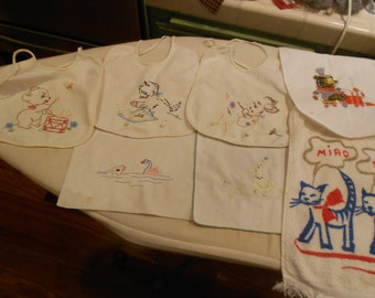 set of baby bibs, embroidered, sweet