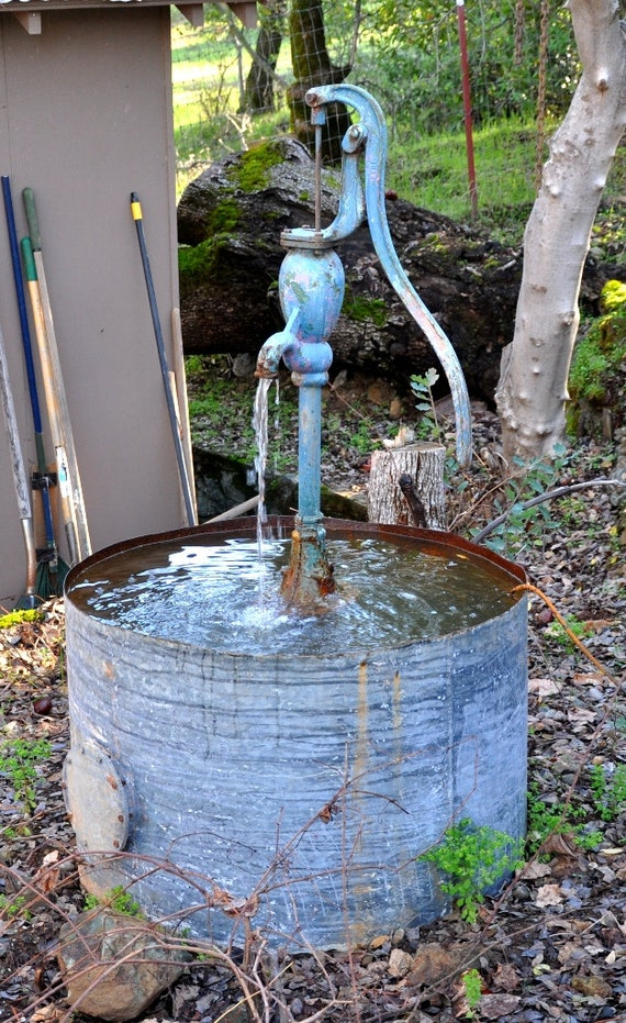 items similar to the blue pump rustic water fountain on