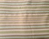 Designer Upholstery Fabric in Blue, Brown, Green and Tan stripe pattern.
