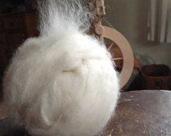4 oz. Bright white kid mohair (first cuts), combed top, and angora wool blend roving 70/20/10