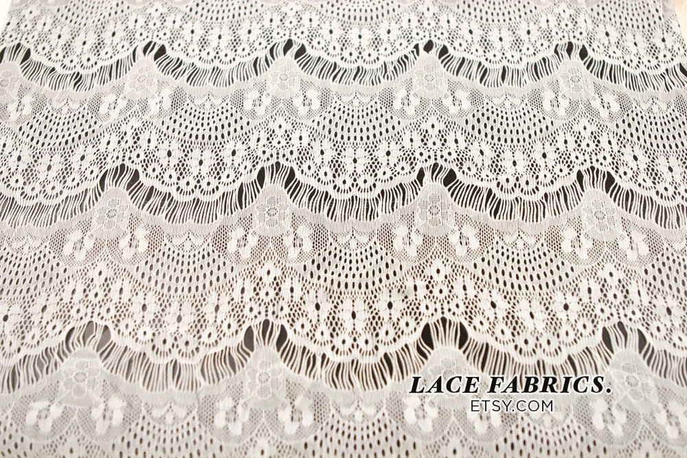 Off white stretch eyelash lace fabric by the yard or wholesale for Cheap fabric by the yard