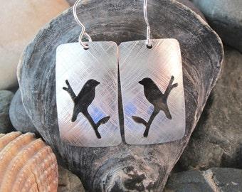 Handmade bird on a branch aluminium earrings