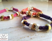 Three Suede braided bracelets with hex enamelled nuts