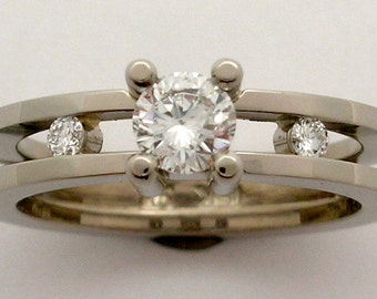 Hand Made from Recycled 18k white gold and claw set Canadian Diamond and Channel set side diamonds Engagement ring