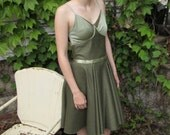 One of a kind knee length pale green dress with open back and adjustable straps Copy