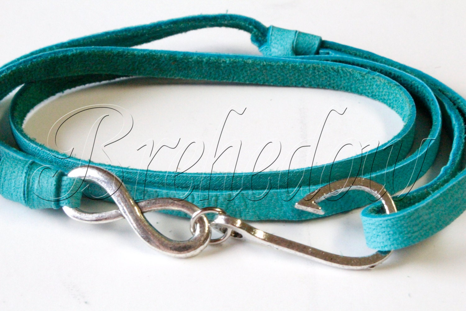 Silver infinity fish hook bracelet on turquoise blue by for Leather fish hook bracelet