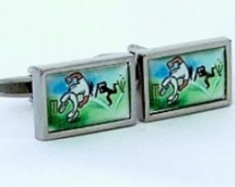 Cricket cufflinks with an original fun image of a bowler taking a wicket