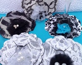 Made-to-order, black /white and silver wine coasters make trend setting and eye-catching wedding favors or gifts.