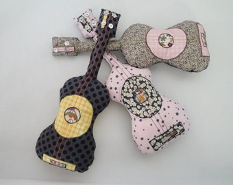 Guitar shaped musical cushion