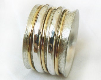 Distinctive wide spinner ring, worry ring, sterling silver with three yellow gold spinner hoops and two thicker silver hoops, Ilan Amir