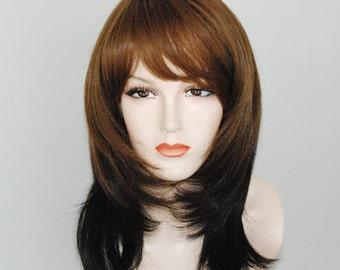 Light auburn mixed with deep auburn and dark brown/ layered wig