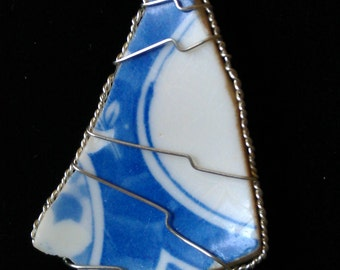 Blue and white patterned porcelain pendant, wrapped in silver finished wire.