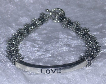 Love slide bracelet with silver spacers