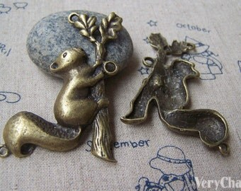 4 pcs of Antique Bronze Squirrel On Tree Trunk Pendants Charms 37x56mm A3356