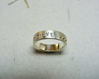 Silver ring with 14kt yellow gold and text