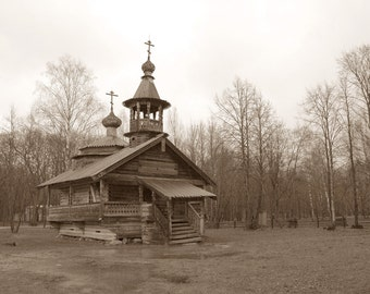 Wooden Chapel. Ancient Architecture. Onion Dome Church. Pine trees. Sepia. Novgorod, Russia.