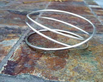 Tangle Bangle- heavy sterling silver bangle bracelet wrapped three times around