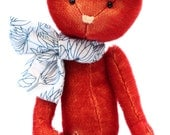 Rosie the red teddy bear with cute neck scarf