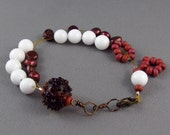 Row counter bracelet in maroon pearls and white beads, abacus for knitting and crochet.