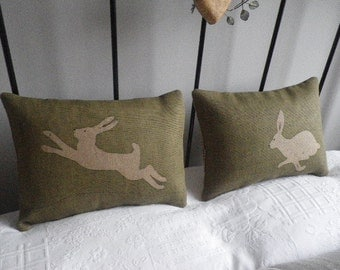 hand printed and stitched pair of olive logo hare cushions