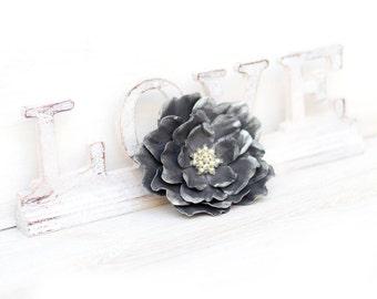 Grey leather flower brooch