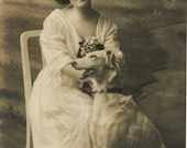 Antique Real Photo Postcard - Woman holding a Dog dated 1912