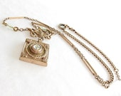 Antique deco nouveau assemblage necklace with pale green stone 'The Small Rain Down Can Rain'