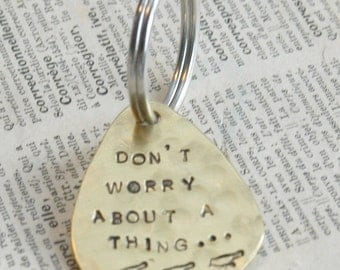 Hand Stamped Brass Guitar Pick Keyring- Bob Marley Lyrics, Three Little Birds, Don't Worry About A Thing By Inspired Jewelry Designs