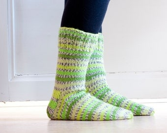 Hand knit socks in durable woolblend yarn in spring green hues, neon green yellow.