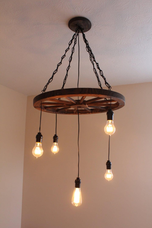 vintage industrial wagon wheel chandelier. Black Bedroom Furniture Sets. Home Design Ideas