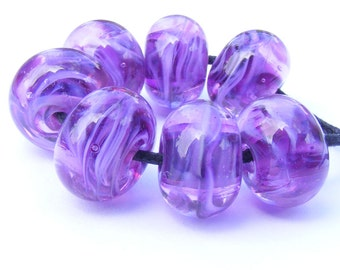 handmade lampwork bead set of 7 magenta and pink swirly beads