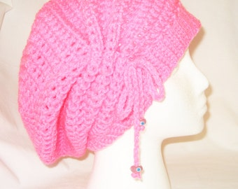 Crochet hat cinched slouchy in bright pink made to fit teens and adults