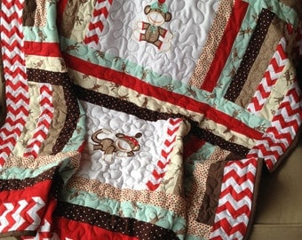 Blue, red chevron, brown, and cream sock monkey baby quilt approx. 50x58