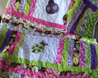 Lime green, pink, brown, and purple baby girl ladybug quilt