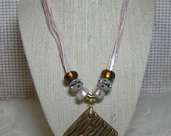 Necklace: Ceramic Chocolate Brown Pendant and Pink Ribbon Necklace with Brown, Pink, and White Accent Beads