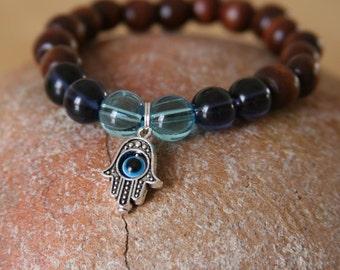 Yogi inspired wood bead bracelet with evil eye hamsa hand charm and blue glass beads
