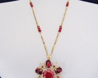 Vintage combination pin and pendant, 1960's starburst pendant with dark red stones, pendant that can also be worn as a pin